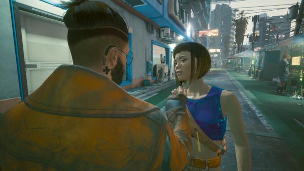 Ви знакомится с девушкой в синем топике.