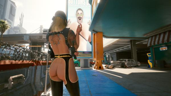 Блондинка Ви на фоне билборда.